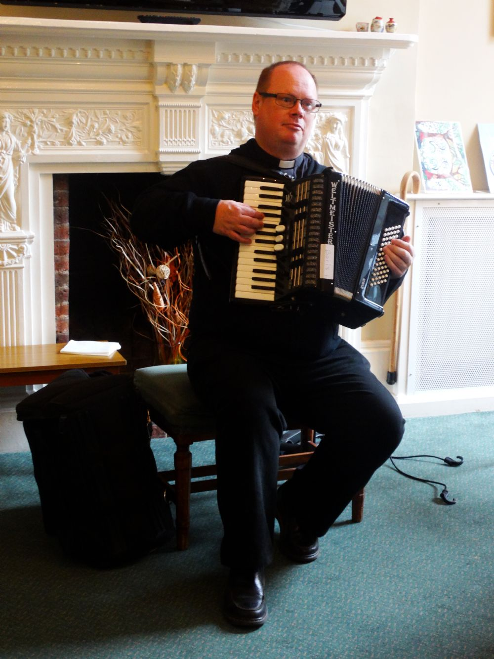 The Reverend Tim Goode Playing the Accordion